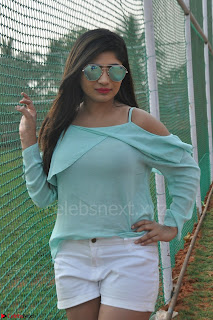 Madhulagna Das looks super cute in White Shorts and Transparent Top 03.JPG