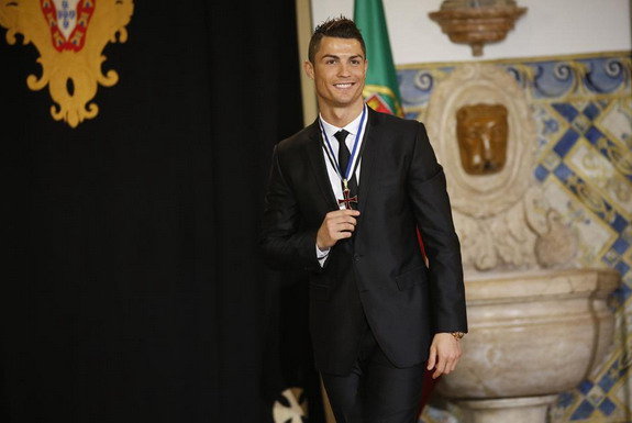 Cristiano Ronaldo poses after he was decorated with the award of the Order of Prince Henry
