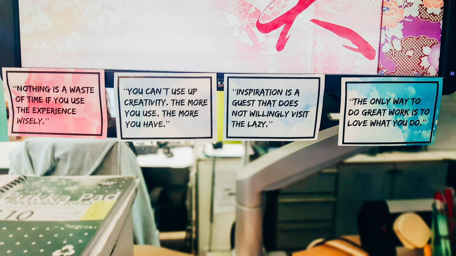 Motivational quotes on a desk.