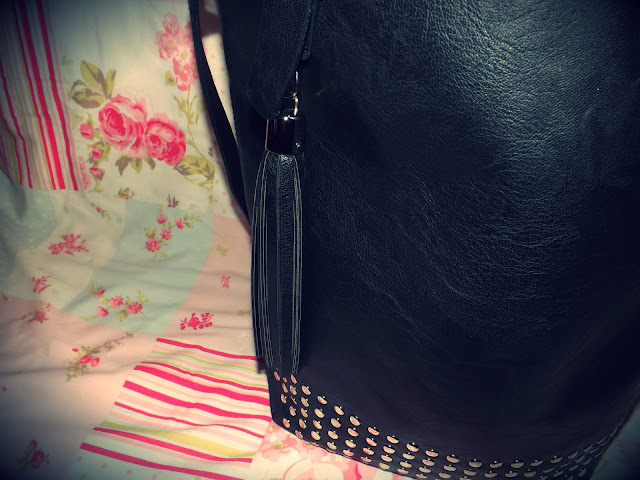 Black studded bucket bag close up