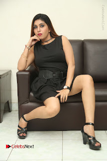 Tollywood Upcoming Actress Pooja Roshan Stills in Black Short Dress at Plus 1 Movie Trailer Launch  0344.JPG