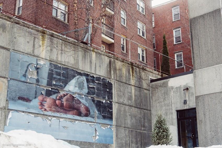 Portland, Maine USA January 2018 photo by Corey Templeton. A bit of large-format art stuck on a wall on Cumberland Avenue.