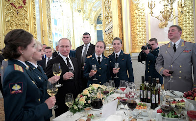 Russian President Vladimir Putin with military academy graduates at a reception in their honor.