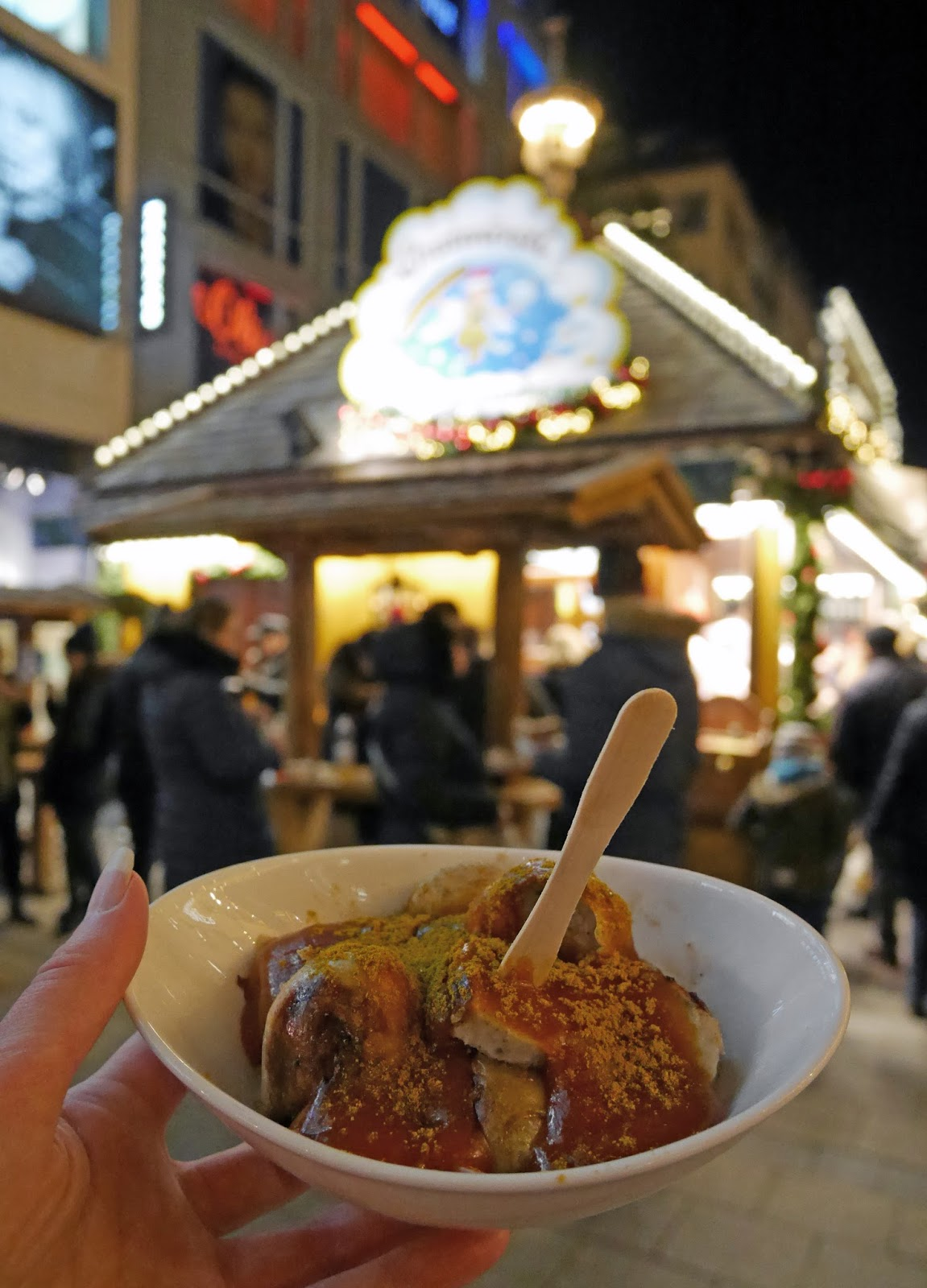 Trying currywurst at the Munich Christmas Markets