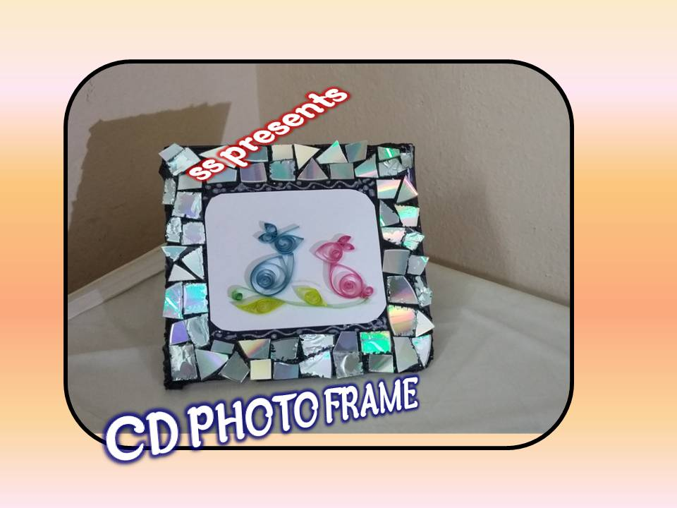 CD and paper quilling birds photo frame   SSARTSCRAFTS