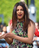 Priyanka Chopra looks super cute in happy mood wearing a short flower print dress in Hollywood 019.jpg