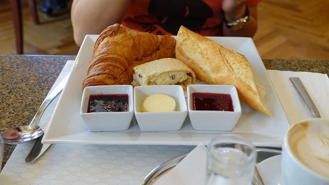 French breakfast croissant au beurre, baguette, curd strudel, butter, marmelade
