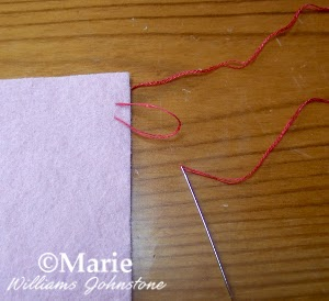 step 3 demonstrating hand sewing stitch