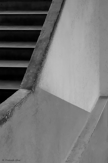 A Black and White Minimalist Photograph of a part of a Staircase at Orbit Mall, Jaipur, Shot on Canon EOS 6D Mark II with 100 mm Lens