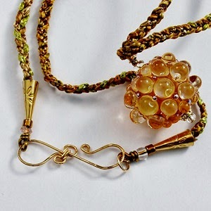 http://www.artfire.com/ext/shop/product_view/wiresNpliers/7839209/happy_new_year_bubbly_champagne_lampwork_pendant_necklace__/handmade/jewelry/necklaces/lampwork