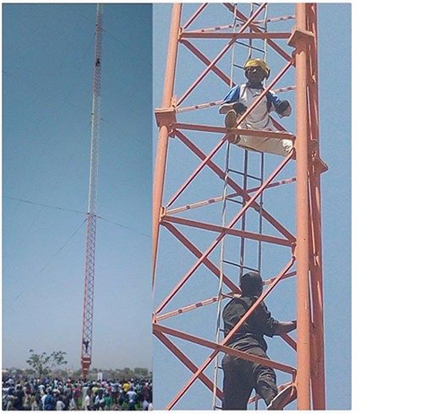 kano business man climbs broadcasting mast