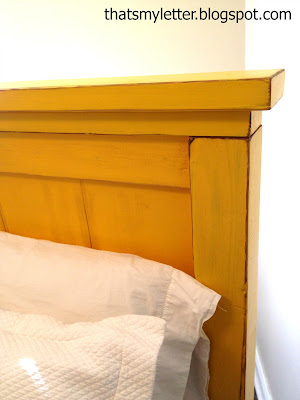 rustic looking farmhouse headboard