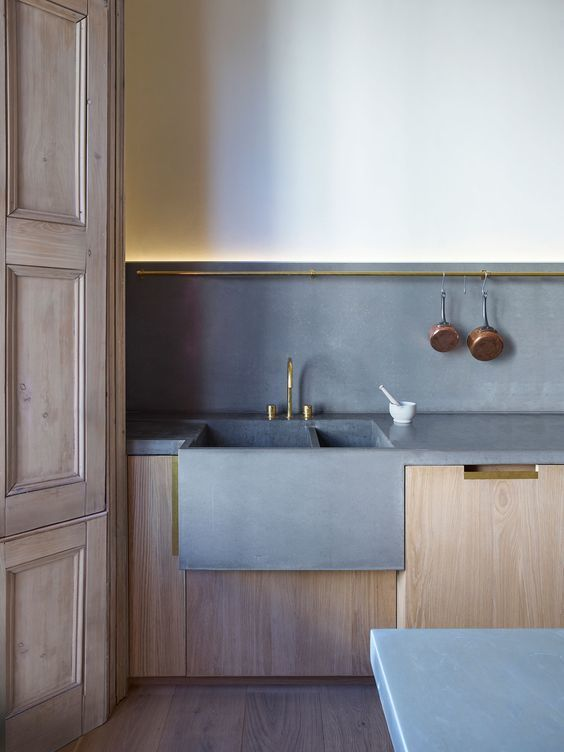 Concrete kitchen sink and backsplash