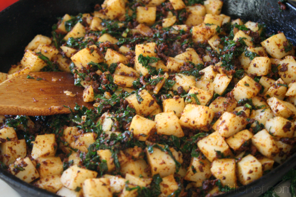 cooking Simply Potatoes with chorizo and kale