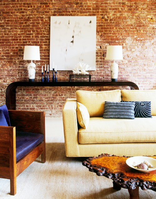 Decoração de sala  com parede de tijolinho a vista
