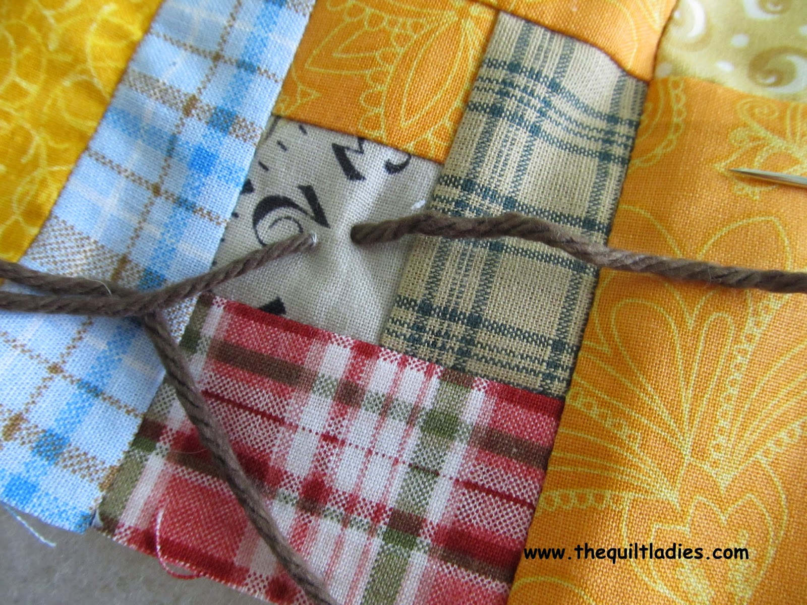 Tutorial on how to tie a quilt with yarn