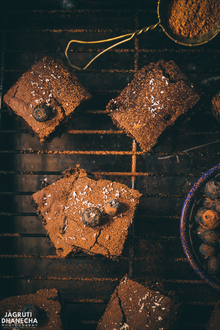 Sometimes you just crave sticky, fudgy brownies straight from the oven. These Eggless Coca-cola Brownies comes together in less than 30-40 minutes. The star ingredient in this recipe is regular coca cola and condensed milk. The cola creates the lightest crust with a melt-in-the-mouth moist centre. These Eggless cola/coke brownies can satisfy even those who aren't big fans of cake.