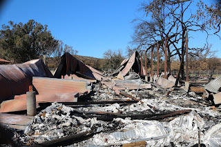 Picture of the burned down pole barn at the back of Western Town