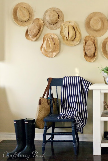 Collection of hats hung on the wall from Craftberry Bush #gallerywall #decorating #decoratingideas #andersonandgrant