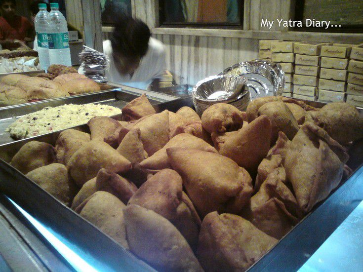 Samosas on sale at a food stall in ISKCON temple, Vrindavan