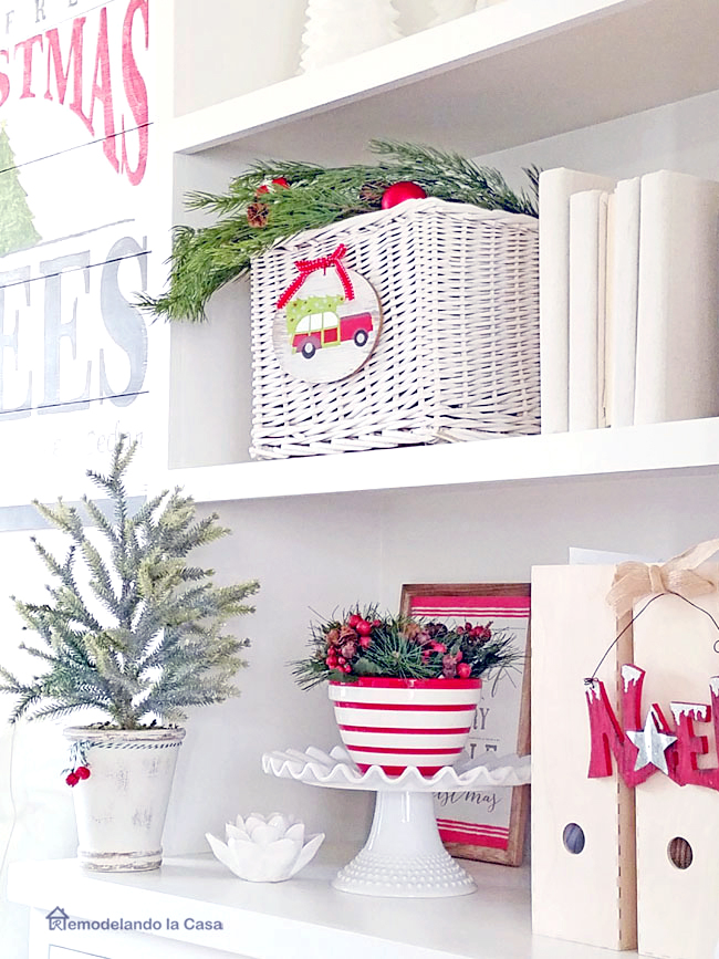 White and red Christmas decor on the shelves