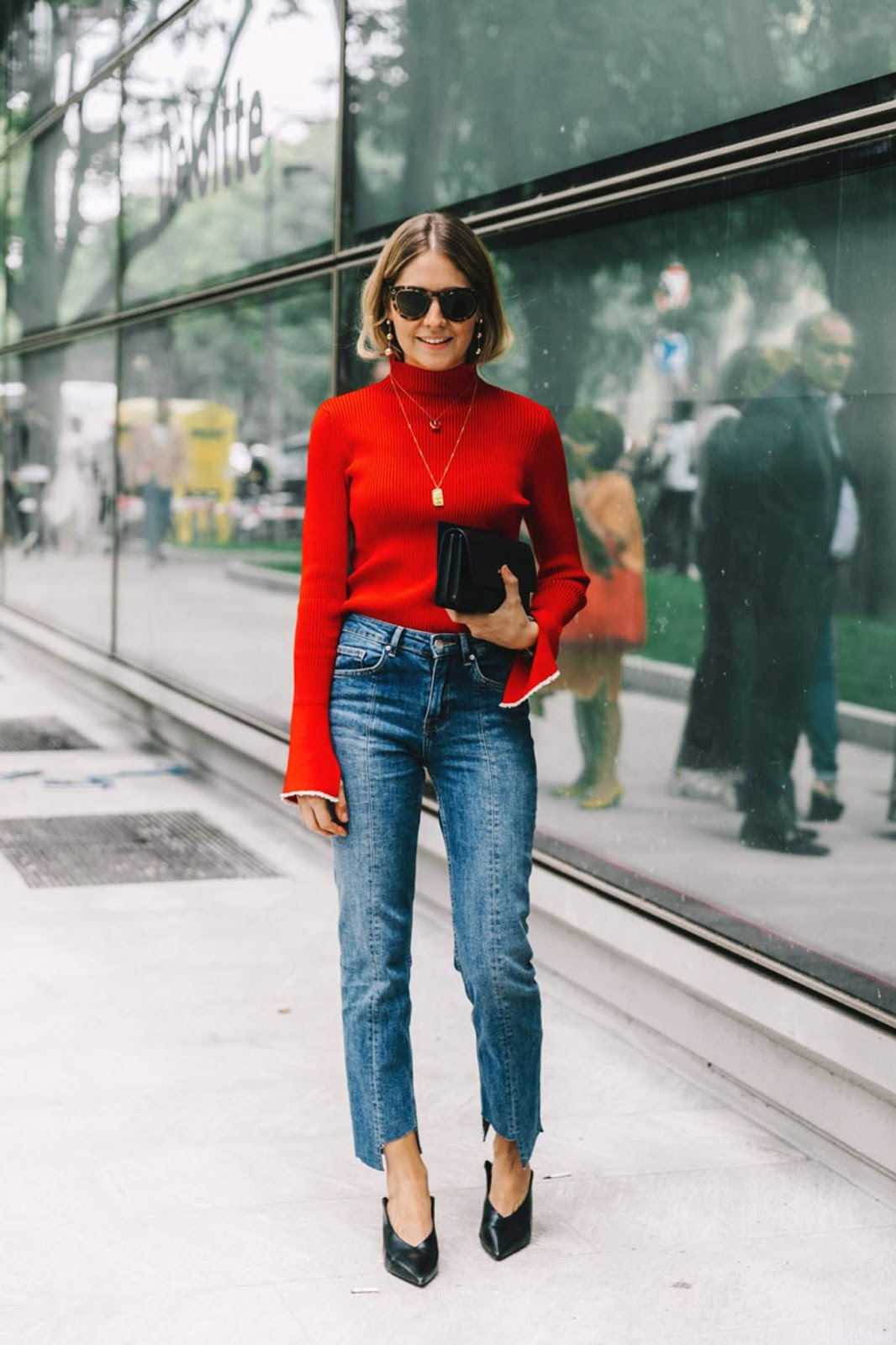 25 Stylish Bell-Sleeve Sweaters to Shop Now — Street Style Outfit Idea With a Red Flare Sleeve Sweater and Jeans