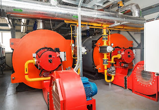 Two gas fired boilers in a boiler room