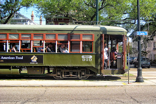 Passengers board the Saint Charles Avenue streetcar in New Orleans, Louisiana