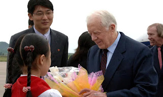 Jimmy Carter offers peace talk with North Korea's Kim.