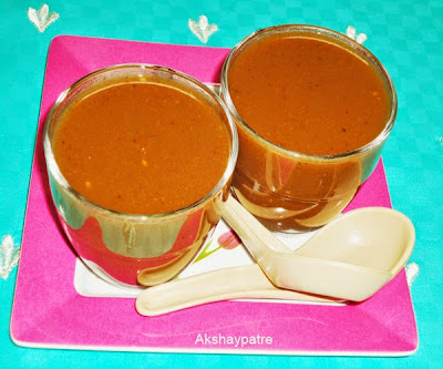 carrot tomato soup in serving bowl