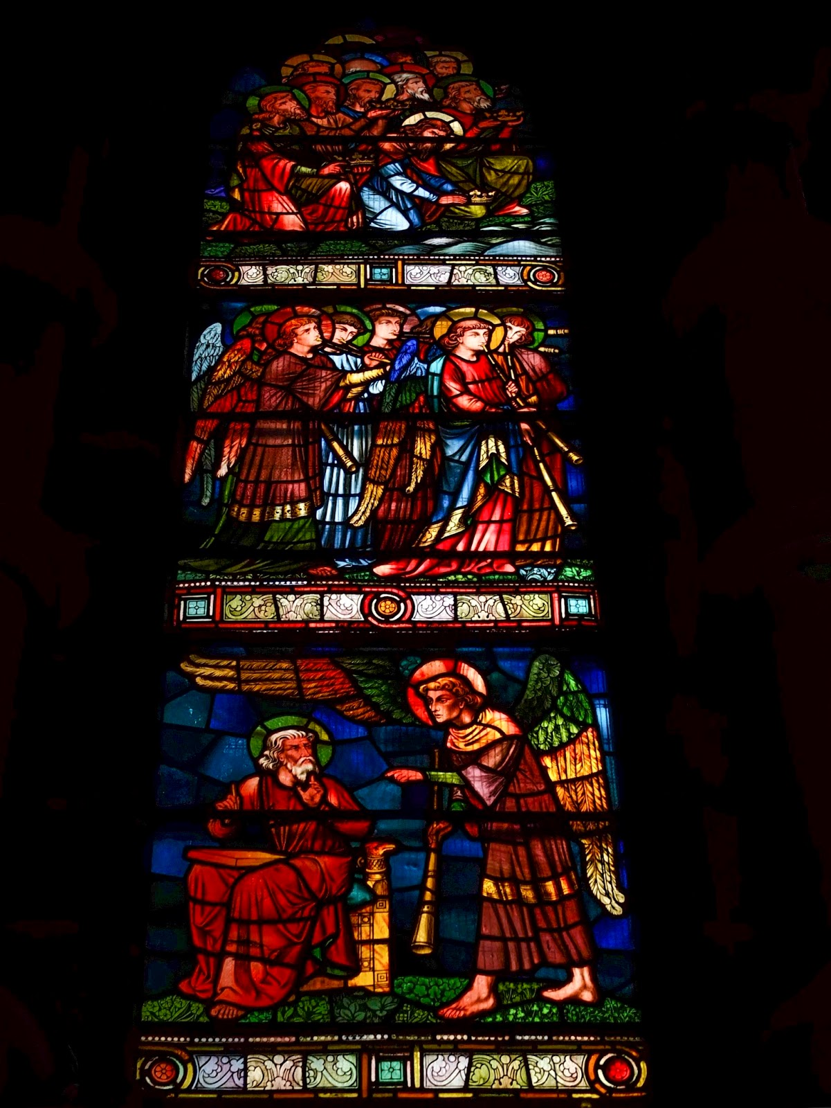 A large stained glass window in St Fin Barre's Cathedral, Cork City.