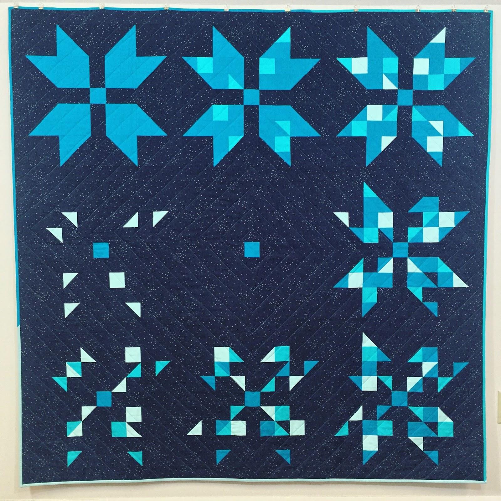 http://ablueskykindoflife.blogspot.com/2015/12/fading-star-quilt-finish.html