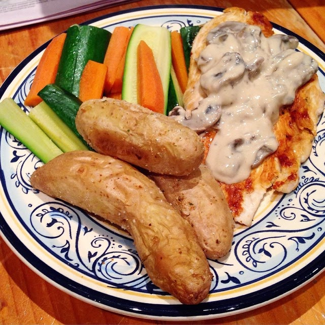 Grilled chicken with creamy mushroom sauce, steamed vegetables and roasted kipfler potatoes