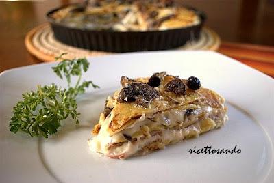 iriceta base di crespelle alle patate presentate in un gustoso tortino a base di  funghi