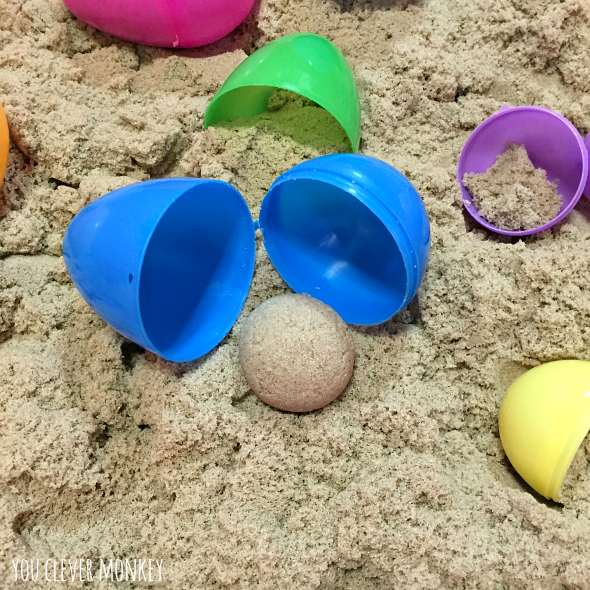 Easter Eggs and Kinetic Sand - create this simple sensory rich invitation to play and be amazed at the opportunity it creates to learn about 3D shapes during play | you clever monkey