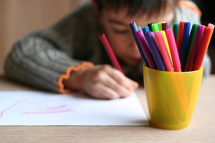 NAMC montessori focusing on desired behavior friendship theme classroom boy drawing poster