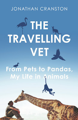 The Travelling Vet Book by Jonathan Cranston pictured with a Giraffe