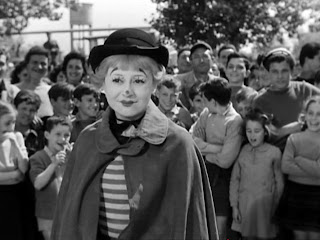 Giulietta Masina as Gelsomina (performing in front of the audience) in La Strada, Directed by Federico Fellini