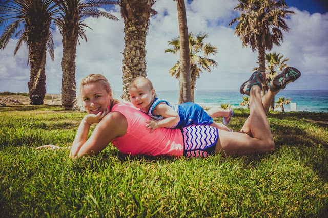 Baby and mom in beach