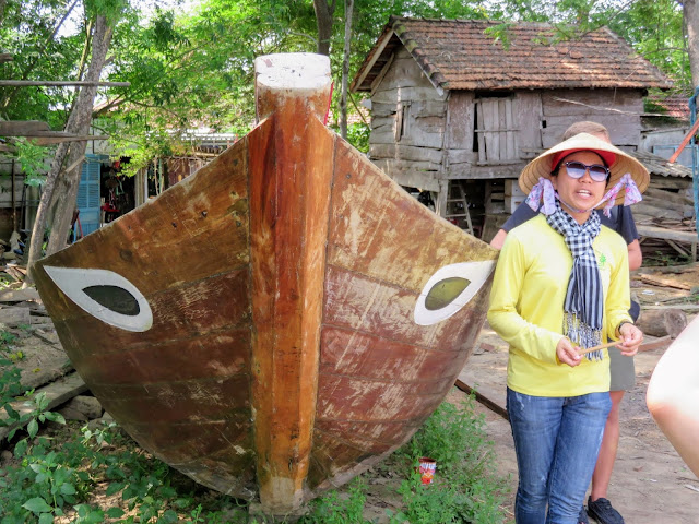 A traditional Vietnamese boat with eyes