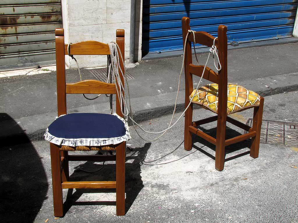Chair keeps another chair on a leash, Livorno
