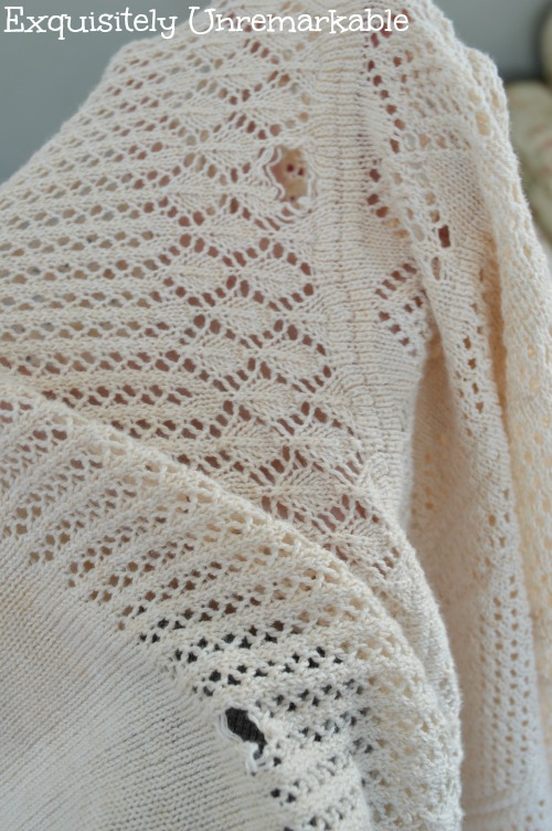 Cream sweater with torn holes