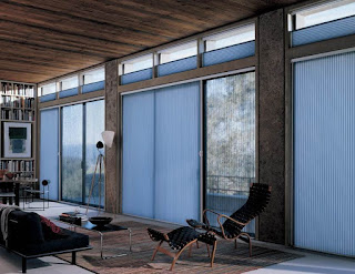 cool blue curtain drapes sliding glass door feats black lounge chair and narrow long coffee table
