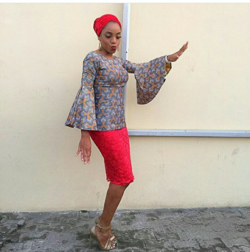 Wide hand ankara top and red skirt
