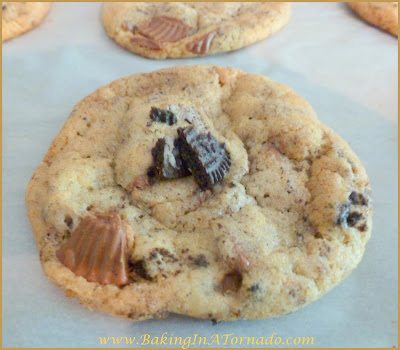 PB Cup and Oreo Cookies: Two favorite treats meet up in one cookie. Crispy, crunchy and not too sweet. Recipe by BakingInATornado.com | #bake #cookies