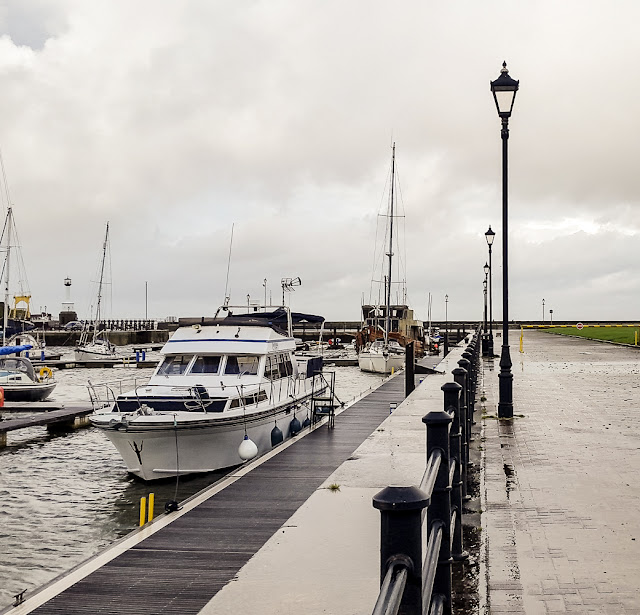 Photo of Ravensdale and the pontoon alongside the walkway at high tide