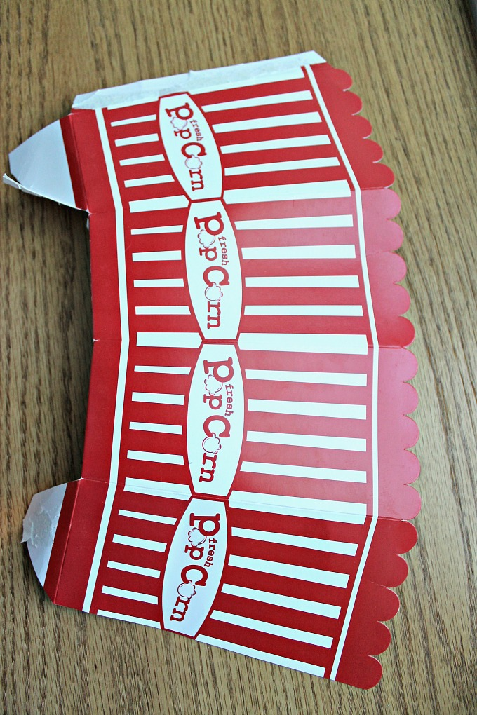 Upcycle a plain popcorn box into this cute Halloween treat wrapper!