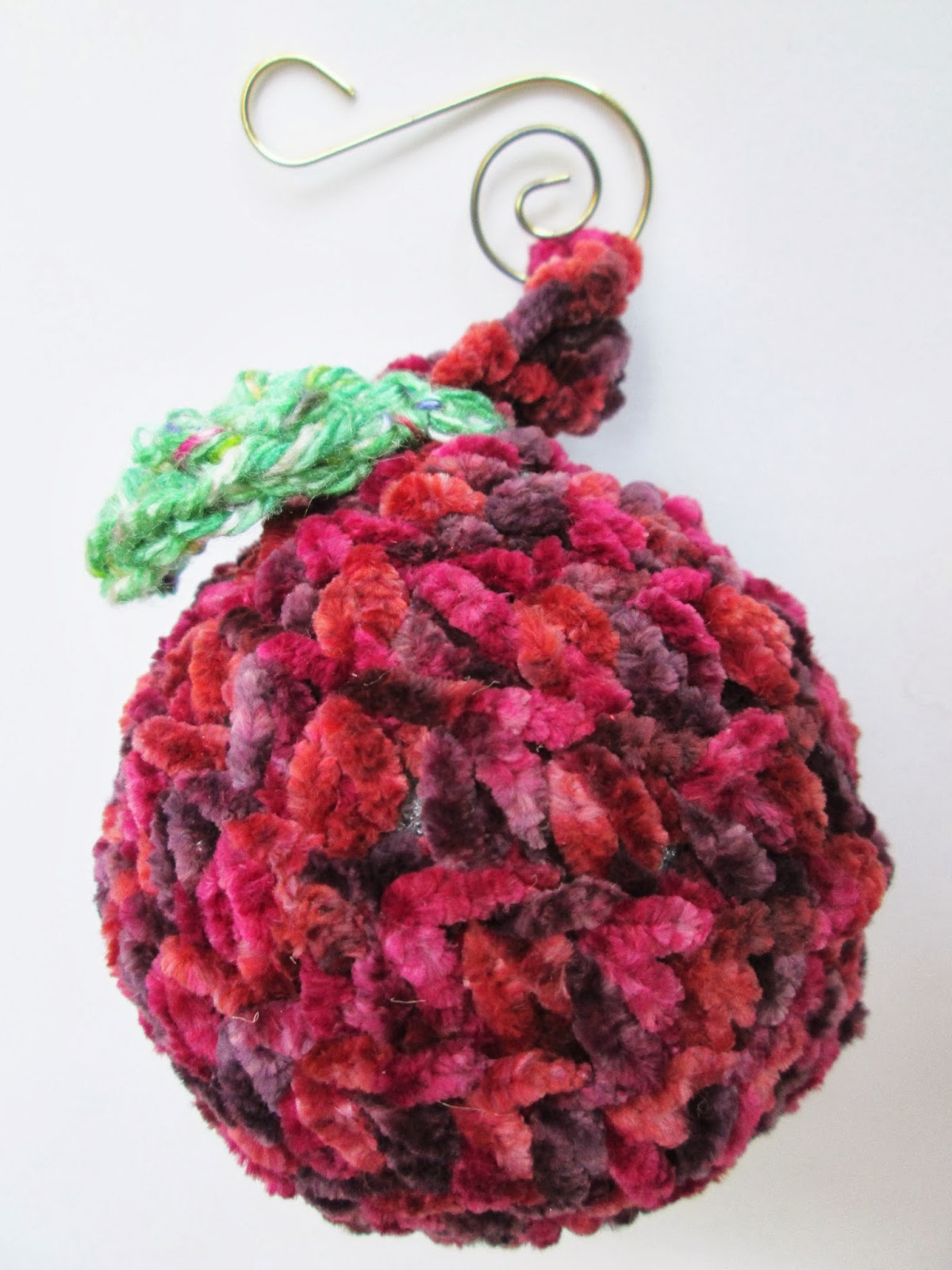 A Crochet Apple Christmas Tree Ornament Made with Chenille Yarn