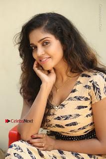 Telugu Actress Karunya Chowdary Stills in Short Dress at ATM Not Working Press Meet  0223.jpg