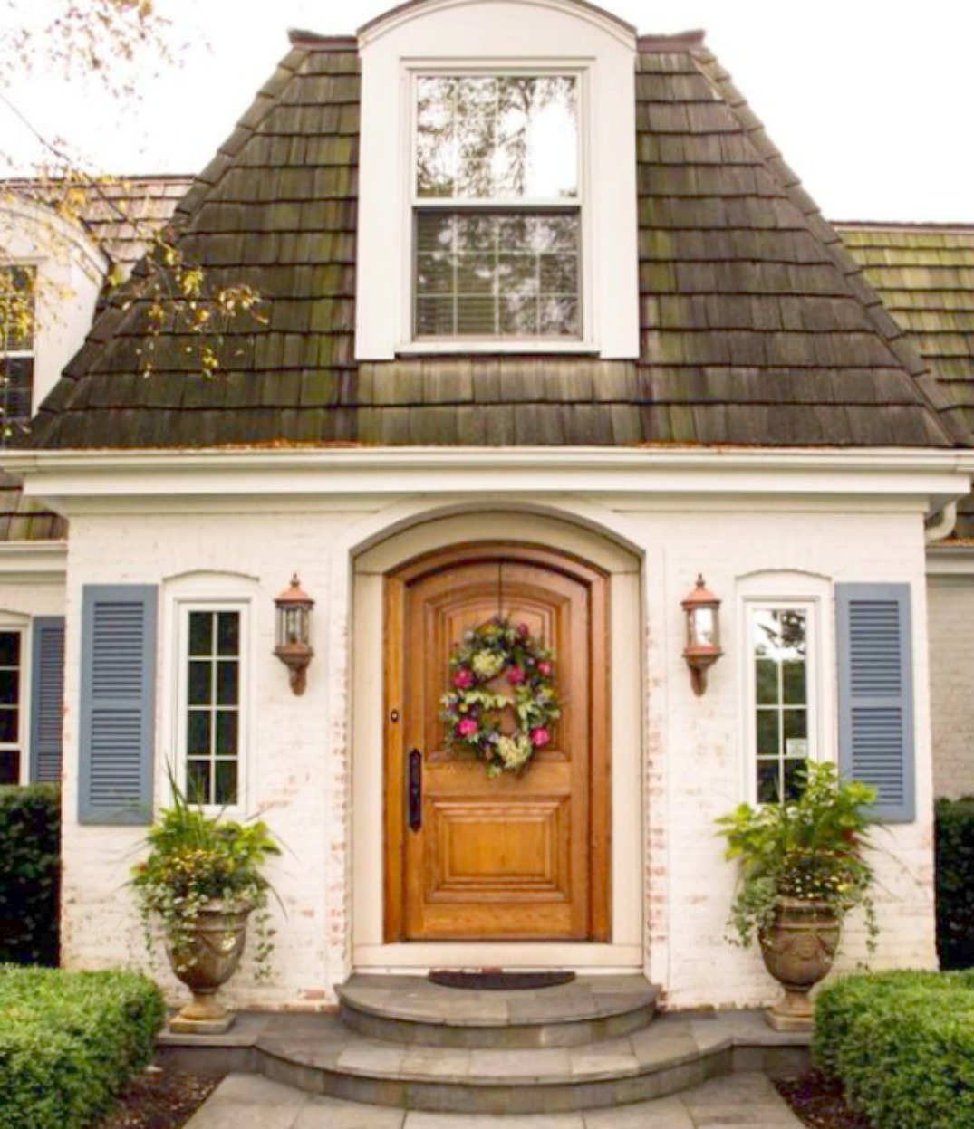 Storybook fairytale home with blue shutters wood door and for Beautiful home exteriors